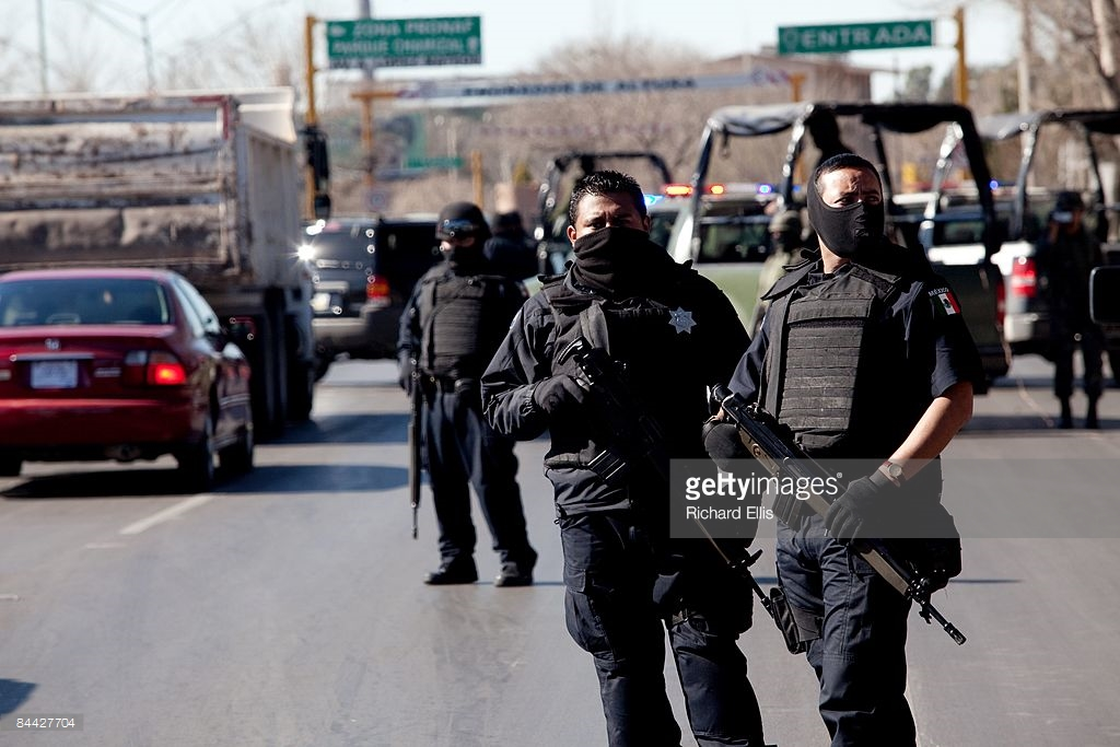 Mexican border guards, masked for their protection.